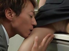 Short haired babe Yuuki is working at the office and her colleague begins naughty things with her. That babe can't refuse him and as well begins to enjoy with him. He spreads her legs and begins rubbing her pussy & after some time he begins to undress her right in the office.
