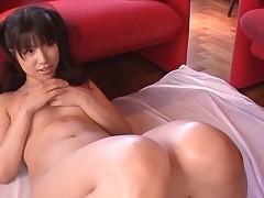 Breasty Oriental charms a palpitating pecker with wet engulfing